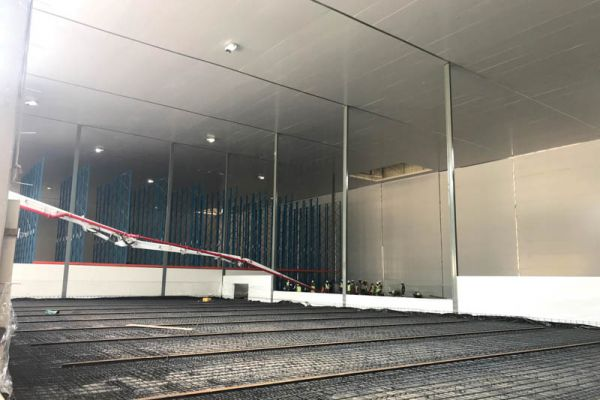A prepped and ready floor is waiting to receive concrete. Here the vapour barrier is laid with mobile racking tracks installed and re-enforcing for the many tons of produce to be stored.